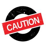 Caution stamp rubber grunge Stock Photography