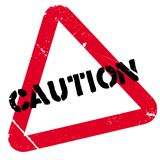 Caution stamp rubber grunge Royalty Free Stock Image