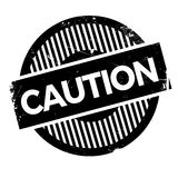 Caution stamp rubber grunge Royalty Free Stock Photo
