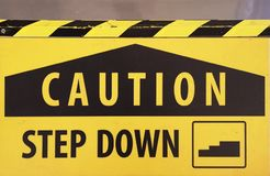 Caution step down sign royalty free stock photography
