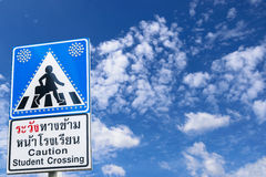 Caution student crossing signboards on beautiful blue sky with clouds in the clear day. Stock Photos
