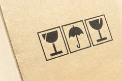 Caution symbols on carton box Royalty Free Stock Photography