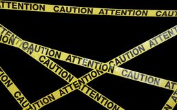 Caution Tape. Many strands of caution tape stretch across the frame royalty free stock images
