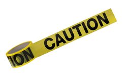 Caution Tape. A roll of caution tape is isolated on a white background royalty free stock photos