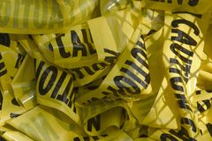 Caution Tape. Waded up in the trash Stock Photos