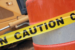 Caution tape. And orange barrel in construction zone stock images