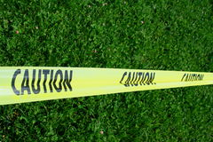 Caution Tape. Close up of a yellow caution tape stock image
