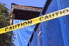 Caution Tape and Apartment Fire Royalty Free Stock Photos