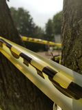 Caution Tape. Around a tree Royalty Free Stock Photography