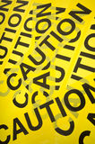 Caution Tape Background. Yellow barrier tape with the word Caution, great background Royalty Free Stock Photos