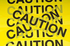 Caution Tape Background. Yellow barrier tape with the word Caution, great background Royalty Free Stock Image