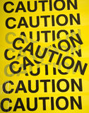 Caution Tape Background. Yellow barrier tape with the word Caution, great background Stock Photography