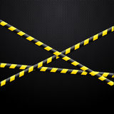 Caution tape on black background Royalty Free Stock Photography