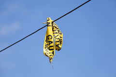 Caution tape. With blue sky Royalty Free Stock Photos