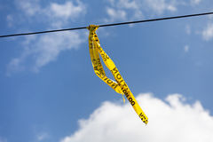 Caution tape. With blue sky Royalty Free Stock Photo