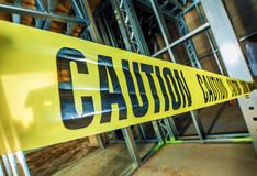 Caution Tape Closed Zone. Yellow Caution Tape Closed Construction Zone. Dangerous Area Within Industrial Area royalty free stock photography