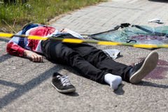 Caution tape and dead man Stock Images
