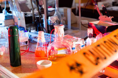 Caution tape in hazardous biochemicals laboratory. With equipment royalty free stock photos