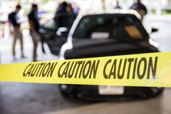 Caution tape protect vehicle in crime scene investigation traini Stock Photo
