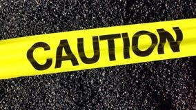 CAUTION Tape Sign Fluttering Above Asphalt stock video