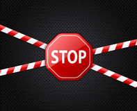 Caution tape and stop sign on black background Royalty Free Stock Photography