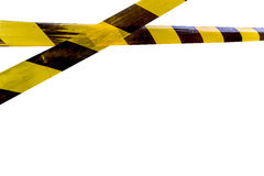 Caution tape. Tape yellow and black color line  notice do not cross or pass,di-cut isolated on white background with clipping path Royalty Free Stock Photo