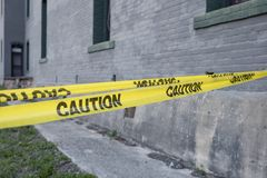 Caution tape yellow sections off an area for safety access. Caution tape yellow sections off an area for safety restriction access Stock Images