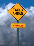Caution taxes ahead post sign Royalty Free Stock Photo
