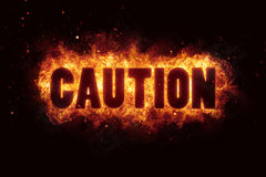 Caution text flames fire burn explosion warning Royalty Free Stock Images