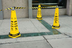 Caution. Three yellow cones with the message Caution Stock Images