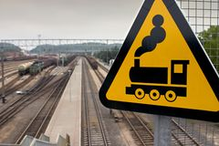 Caution: Train. Railyard sign outside Vilnius, Lithuania Royalty Free Stock Photo