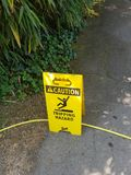 Caution tripping hazard sign. Safety sign warning of a tripping hazard stock image