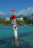 Caution, Turtle Sign. A signpost in a tropical sea, cautioning slow speeds due to Turtles in the area Stock Photos