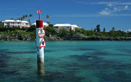 Caution, Turtle Sign. A signpost in a tropical sea, cautioning slow speeds due to Turtles in the area Stock Images