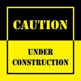 CAUTION UNDER CONSTRUCTION WARNING SIGN Stock Photo