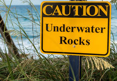 Caution Underwater Rocks Stock Image