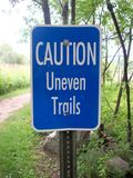 Caution Uneven Trails Sign Stock Photo