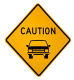 Caution Vehicle Ahead. Isolated yellow warning sign to watch out for vehicles on the roadway ahead which a path crosses Stock Photos