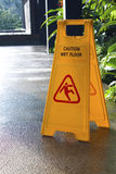 Caution Wet Floor. Signage and wet floor Stock Photo