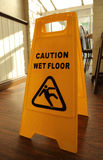 Caution Wet Floor. A sign indicating a need to be cautious as floor may be wet Stock Photos