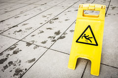 Caution wet floor. Sign at a corridor in vienna Stock Photography
