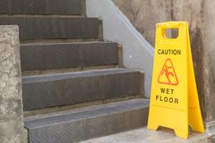 Caution wet floor. Signs were placed at the stairs Stock Images