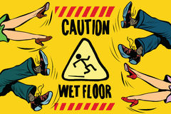 Caution wet floor, feet of women and men Stock Image