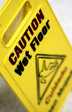 Caution wet floor sign. Close up of caution wet floor sign Stock Image
