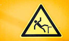 Caution wet floor sign. At a sidewalk Royalty Free Stock Photography