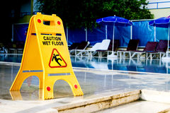 Caution wet floor sign. By the pool Stock Photography