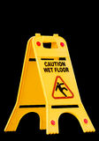 Caution wet floor, sign. Caution wet floor sign isolated on black Stock Photography
