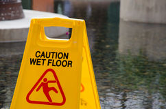 Caution wet floor. Sign board in a hotel Stock Photos