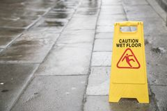 Caution wet floor sign on the outdoor. Close up Royalty Free Stock Image