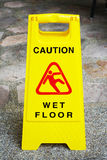Caution wet floor sign on the walkway Royalty Free Stock Photography